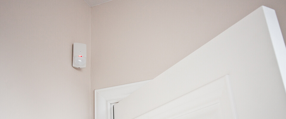 Motion sensor in the corner of a room